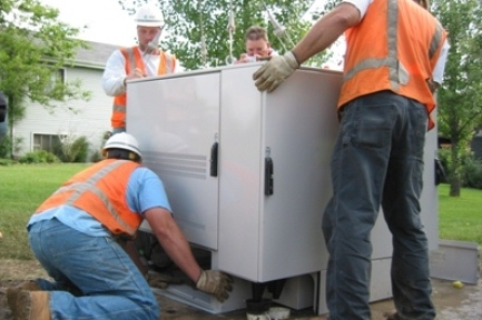 Installation of pad-mount FlexSure FLX16RS delivering triple-play service to neighborhoods