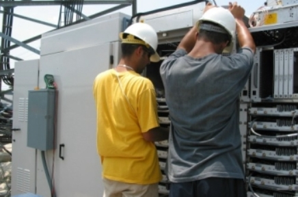Purcell Systems field service experts inspect an outdoor equipment enclosure