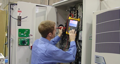 Purcell Systems technical field-expert tests integration of telecommunications equipment